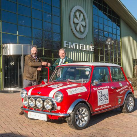 Left to right, Colin Kirkpatrick from Emtelle handing over the keys of the Mini Cooper to Vice Chairman of the BVAC, Ken Grimes.