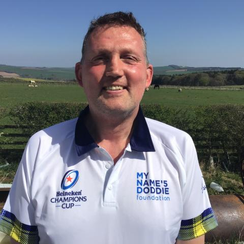 Doddie sports the special edition Raging Bull EPCR rugby polo.