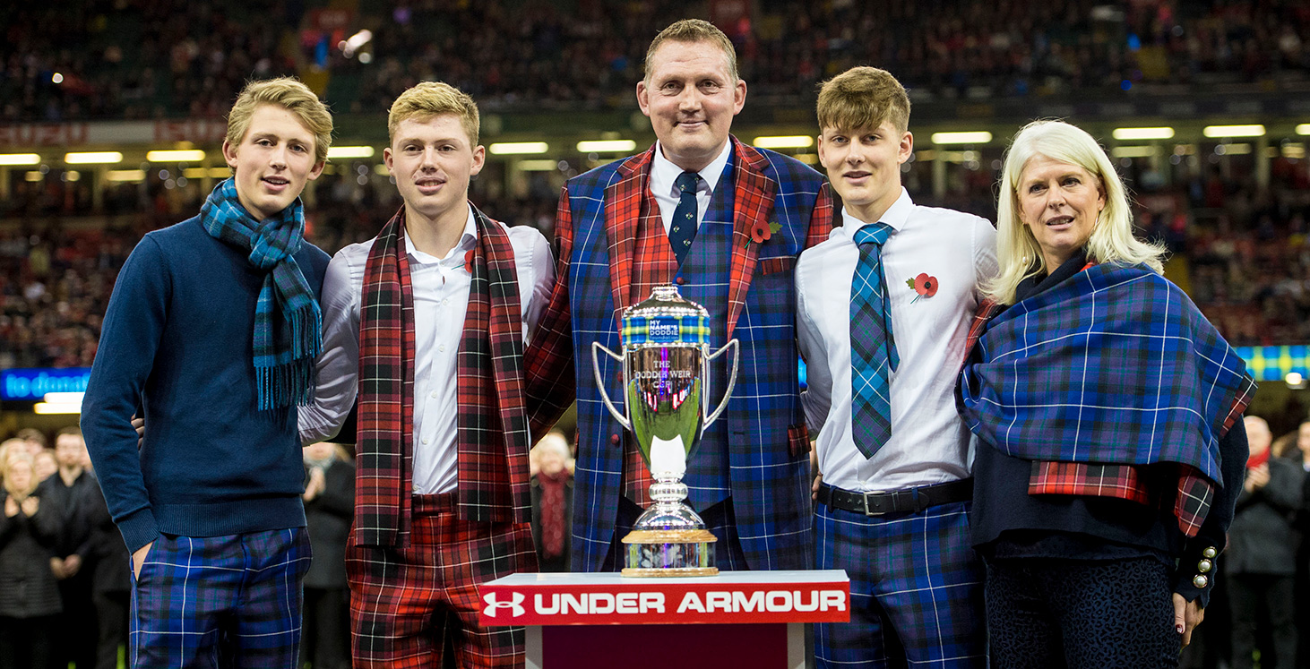 Doddie Weir with his family, and the trophy bearing his name, before kick-off.